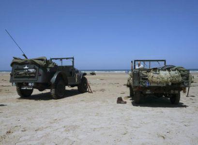 Vyloďovací pláž OMAHA v místě, kde EASY GREEN navazuje na EASY RED. Zatímco Sgt. odhazuje svou uniformu a nahý se s šíleným výkřikem vrhá do moře...